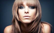 Haircut with Blowout and Conditioning Treatment or Partial Highlights at Grand Central Hair Salon (Up to 65% Off)
