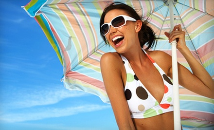 One or Three Spray Tans at Essential Wellness Day Spa (Up to 53% Off)