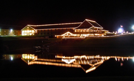 groupon daily deal - 1- or 2-Night Stay for Four with Christmas Package at Santa's Lodge in Santa Claus, IN
