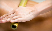 Four-Visit Chiropractic Package with 60- or 90-Minute Massage at Magnolia Specific Chiropractic (Up to 94% Off)