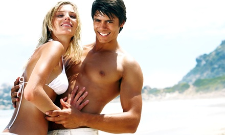 Three Norvell Sunless Spray Tans at Elixir Salon & Day Maker (Up to 54% Off)