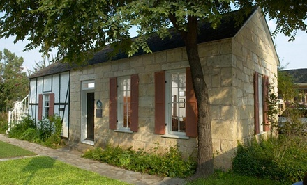 groupon daily deal - 1- or 2-Night Stay for Up to Four in a King or Two-Queen Room at Fredericksburg Inn & Suites in Texas Hill Country