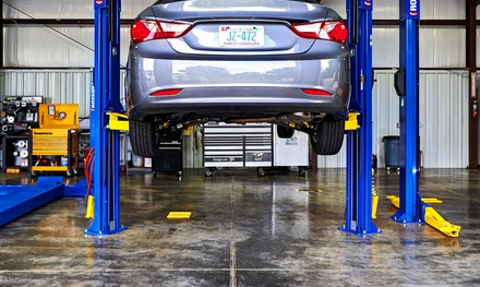 One Preferred Oil Change with Fluid Check and Tire Rotation at Meineke (Up to 43% Off)