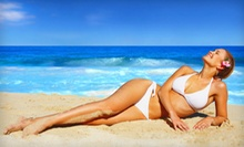 One Month of Unlimited Tanning or Three or Six VersaSpa Spray Tans at Titan Tan (Up to 67% Off)