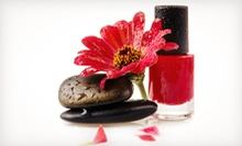 Two Basic Manicures or One Basic Mani-Pedi at Indulging Spa Services (Up to 53% Off)