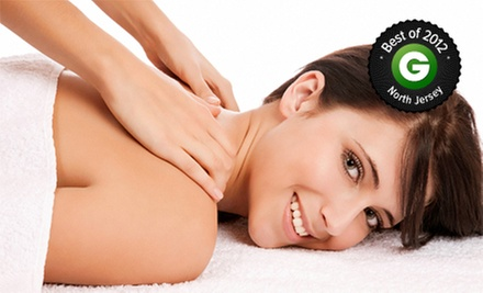 One or Three Body Scrubs, Body Wraps, or Massage Packages at A Pampering Knead (Up to 62% Off)