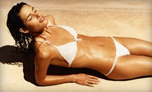 Five UV Tans, Two VersaSpa Spray Tans, or Three Mystic Tan Spray Tans at Darque Tan (Up to 83% Off)