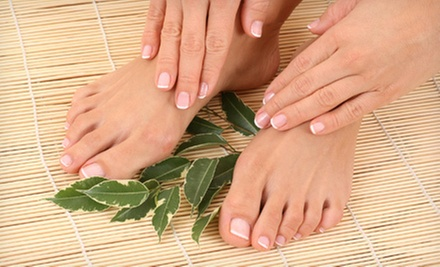 One or Two Mani-Pedis, UV Gel Nails, or Acrylics at Aqua Salon and Day Spa (Up to 62% Off)