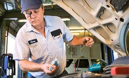 One or Three Oil-Change Packages or One Emissions Inspection Package at Pitstop Lube and Tune (Up to 79% Off)