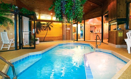 groupon daily deal - 1-Night Stay for Two with a Romance Package at Sybaris Pool Suites – Frankfort in Suburban Chicago
