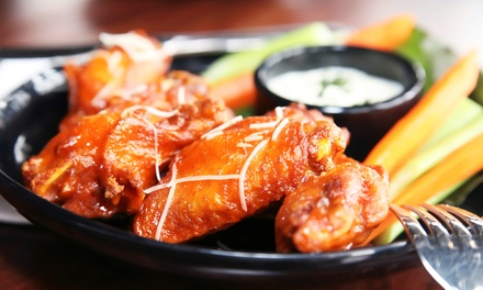 Wings and Beer Pitchers at Sidelines Sports Bar (Up to 50% Off). Three Options Available.