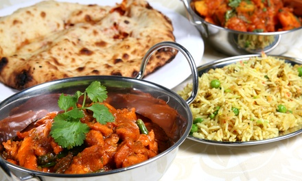 Indian Food at Pooja Restaurant (Up to 52% Off). Four Options Available.