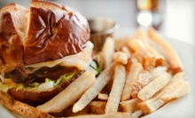 Half-Pound Burgers for Two or Four at C.J. Moloney's (53% Off)