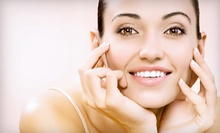 One Fountain of Youth Microdermabrasion Facial or Four Microdermabrasion Sessions at World of Health (Up to 53% Off)