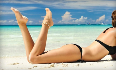 One or Four Spray Tans, Six UV Tanning-Bed Sessions, or a Gift Card at SMART TAN faster-safer UV+ (Up to 57% Off)