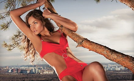 One Month or 200 Minutes of UV Tanning or One or Two Spray Tans at Sun City Tanning Lounge (Up to 75% Off)