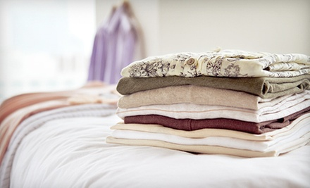 Wash, Dry, and Fold of 20 or 40 Pounds of Laundry or Ironing of 20 Garments at Eco Bubbles Laundry (Half Off)