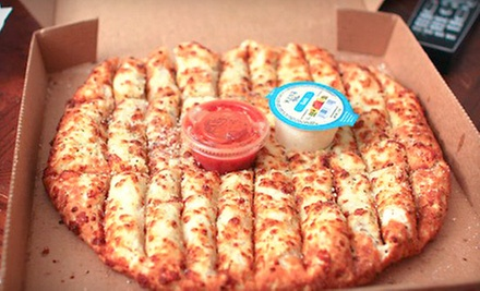 One Extra-Large Pizza with Up to Five Toppings or $10 for $20 Worth of Wings and Cuisine at Gumbys Pizza