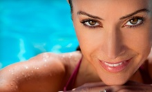 One Month of Unlimited Bed Tanning, Three Spray Tans, or Three Spray-Bed Combination Tans at Ella Blue (Up to 62% Off)