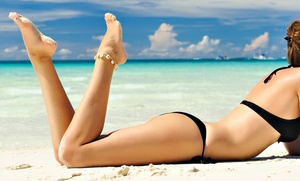 One Month Of Unlimited Uv Tanning Or One Or Three Spray Tans At Island Sun & Bronz Beauty (up To 61% Off)