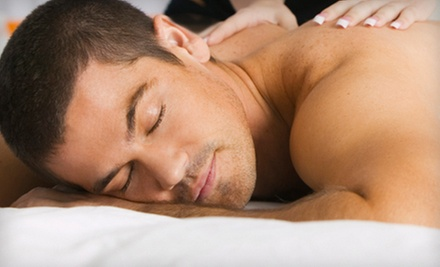 Massage with Exam, Consultation, and Optional One or Three Adjustments at Fremont Wellness Center (Up to 80% Off)