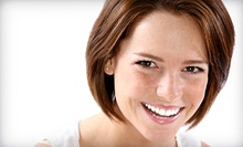Dental Exam, X-rays, and Cleaning with Optional Take-Home Whitening Kit at Definite Dental Solutions (Up to 84% Off)
