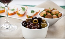 $20 for a Bottle of Wine and Two Tapas at Vineyards of the World (Up to $43 Value)
