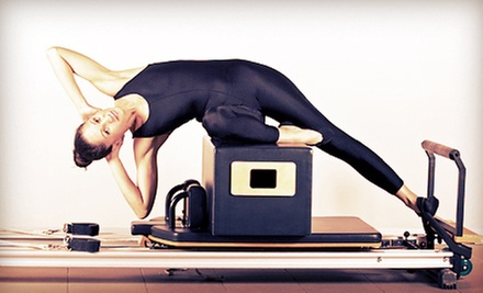 10 or 20 Pilates Classes, or Three Private Pilates Classes at Body Synergy (Up to 82% Off)