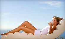 One or Three Airbrush Spray Tans or One Month of Unlimited Silver Bed Tanning at The Club (Up to 64% Off)
