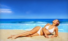 One or Three Spray Tans or Months of Unlimited Bed Tanning at Blazing Beds Tanning (Up to 66% Off)