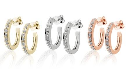 Brincos Huggy em ouro e com diamantes desde 99,99€