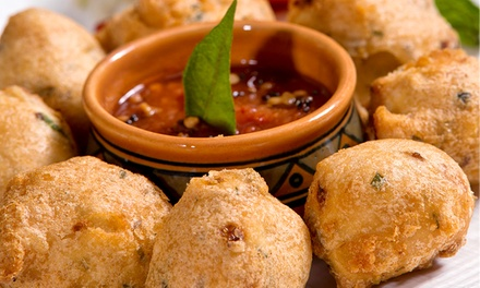 Indian Dinner with Appetizers, Dessert, and Wine for Two or Four at Heritage India (51% Off)
