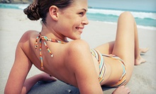 Two or Four Spray Tans, or One Month of Unlimited UV or Spray Tans at Chasing the Sun Tanning (Up to 56% Off)