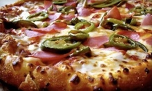 Pan Pizza, Parmesan Bread Bites, and Soda for Four or Two at Domino's Pizza (Up to 53% Off)