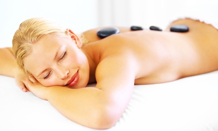 60- or 90-Minute Hot Stone Massage or 45-Minute Foot Massage at Enhance & Beyond (Up to 74% Off)