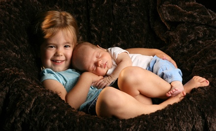 $49 for a Studio or Outdoor Photo Shoot for Up to Eight with Prints and Digital Image at Yuen Lui Studio ($485 Value)