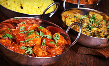 Indian Cuisine at India House Restaurant (Up to 53% Off). Three Options Available.