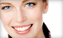 Checkup, Zoom! Whitening with Option for Checkup, or Laser Gum Treatment at Manhattan Family Dental Care (Up to 85% Off)