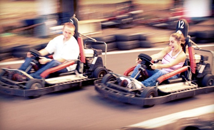 $12 for a Family Package with Five Go-Kart and Mini-Golf Passes and One Photo at Cooter's Place ($45 Value)