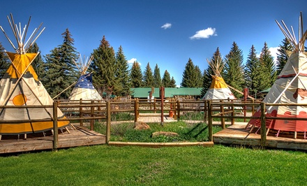 groupon daily deal - 1-Night Stay for Two at Saratoga Resort and Spa in Saratoga, WY. Valid for Sunday–Thursday Check-In.