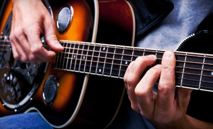 $49 for Four Private Guitar Lessons with Free Lesson e-Book at American Guitar Academy ($ 129.95 Value)