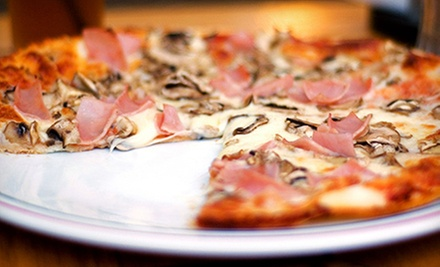 Organic Pizza at Cozmic Pizza (Up to 56% Off). Three Options Available.
