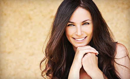 Haircut with Scalp Massage, Relaxer and Rinse, or Full Highlights at Haile Village Spa and Salon (Up to 52% Off)