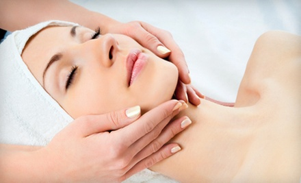 Parisian or Microdermabrasion Facial at Qi Spa (Up to 55% Off)