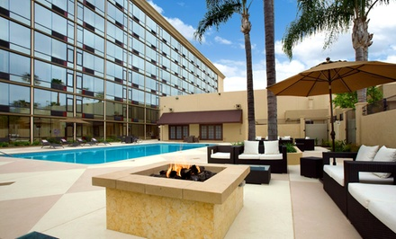 groupon daily deal - Stay with Optional Parking at Red Lion Hotels Anaheim in Anaheim, CA; Dates into June Available