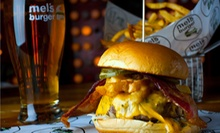 Two Burgers and a Half-Gallon Growler of Beer at Mel's Burger Bar. Four-Person Option Available (Up to 56% Off).