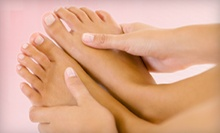 One or Two Mani-Pedis at Infinite Tan & Spa (Up to 55% Off)