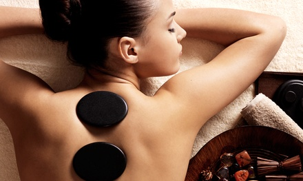 Massage with Hot Stones and Reflexology or Hot Oil, or a Couples Massage at Ample Massage Spa (Up to 63% Off)