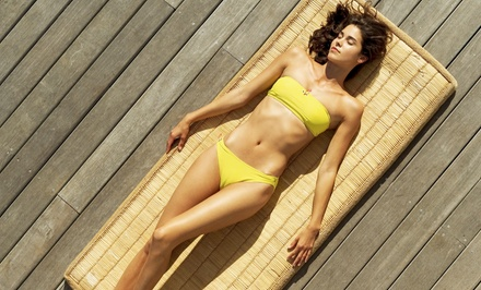 One or Two Airbrush Spray Tans at Aloha Tans (50% Off)