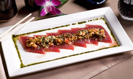 Japanese Dinner for Two, or Miso Soups, Specialty Rolls, and Glasses of Wine for Two at Sakimura (Up to 47% Off)